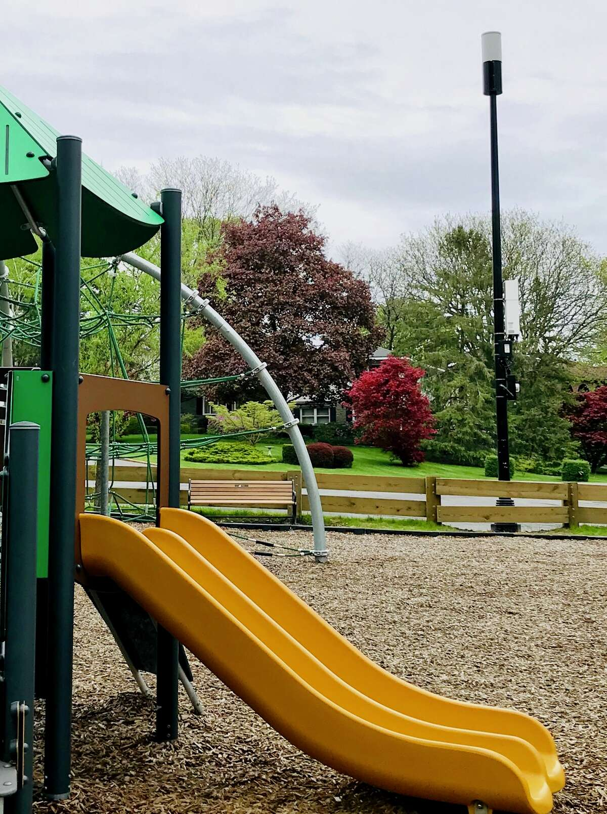 A cell tower was recently installed next to a city playground at Buckingham Lake, angering residents concerned the radio waves could harm children (Paul Grondahl / Times Union)