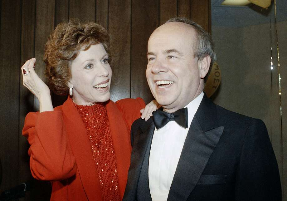"""FILE - In this April 26, 1986 file photo, Carol Burnett, left, and veteran comrade in comedy Tim Conway laugh during a gala birthday party for Burnett in Los Angeles.  Conway, the impish second banana to Burnett who won four Emmy Awards on her TV variety show, starred aboard """"McHale's Navy"""" and later created a very short character named Dorf, has died. He was 85. Conway died Tuesday morning, May 14, 2019,  in a Los Angeles care facility after a long illness, according to Howard Bragman, who heads LaBrea Media.  (AP Photo/Nick Ut, File) Photo: Nick Ut, Associated Press"""