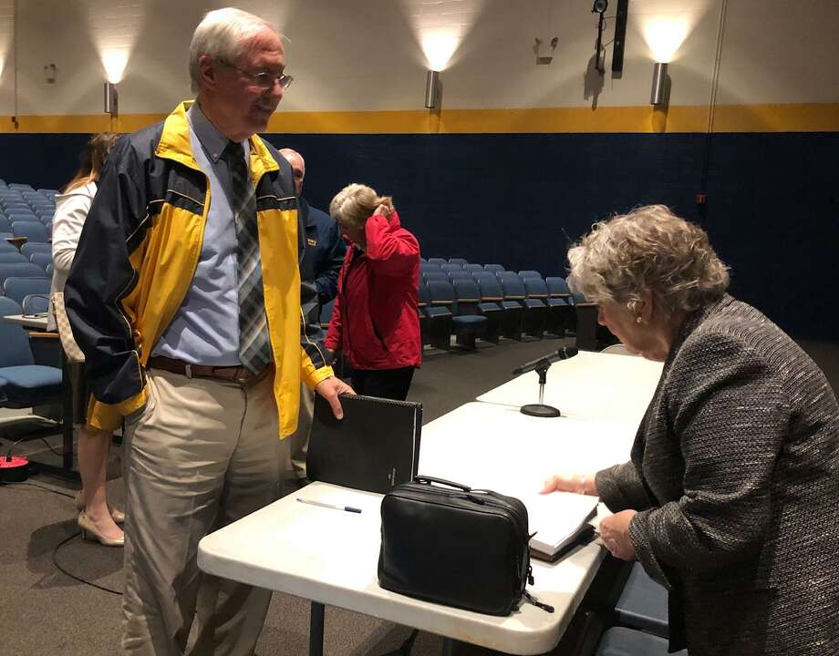 Town Clerk Sheila Sedlak, right with Board of Selectman member Steve Sedlak, right and in background Mayor Candy Perez. Photo: Leslie Hutchison/ Hearst Connecticut Media