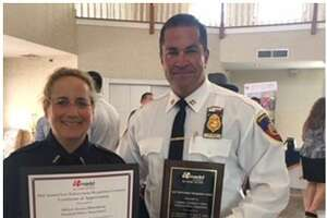 Stamford officer Jessica Bloomberg and Capt. Diedrich Hohn receiving a certificate and plaque at the Connecticut MADD Law Enforcement Recognition lunch held last week.