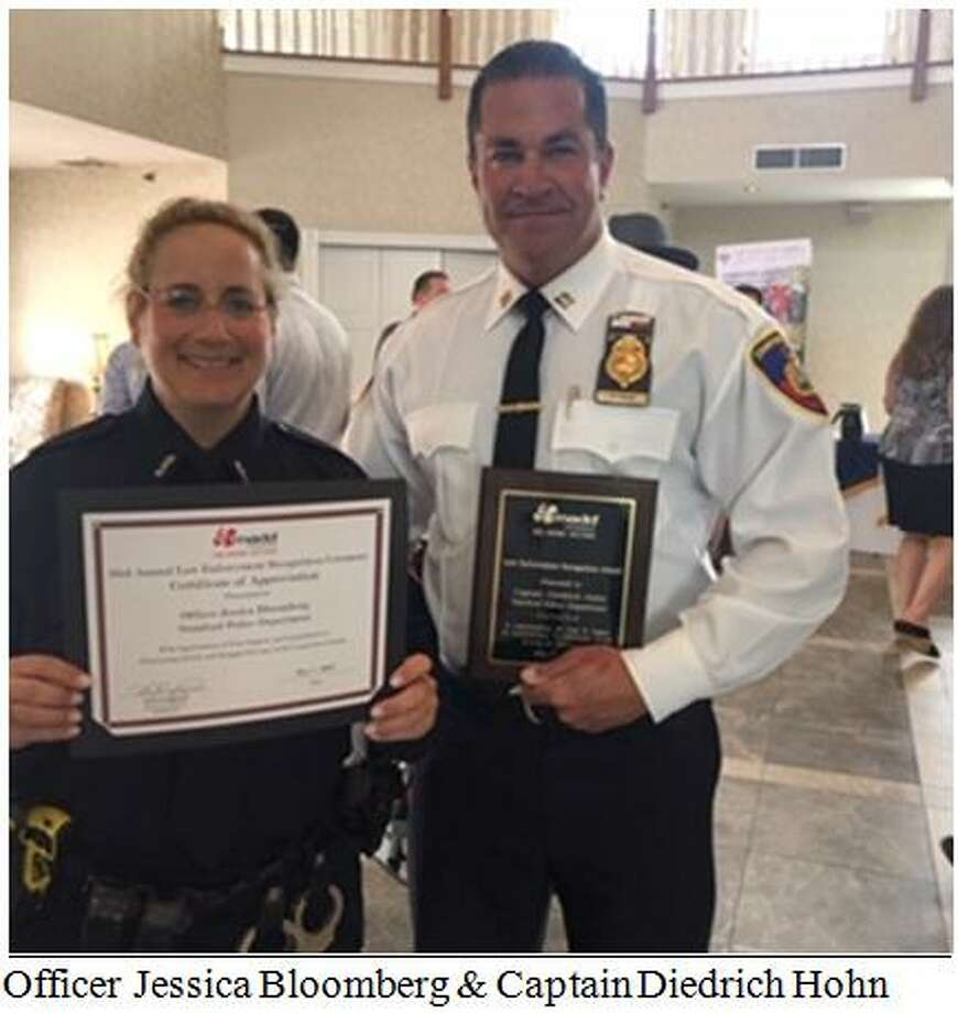 Stamford officer Jessica Bloomberg and Capt. Diedrich Hohn receiving a certificate and plaque at the Connecticut MADD Law Enforcement Recognition lunch held last week. Photo: Contributed / Stamford Police
