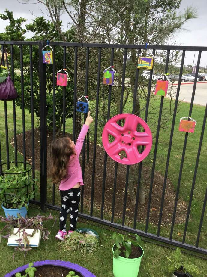 Ariadne R plays in the preschooler-made recycled garden, which was created by her and her fellow Goddard School Katy classmates in honor of Earth Day. Photo: Goddard School Of Katy / Goddard School Of Katy