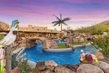 38508 N. 34th Ave, Phoenix, AZ Price: $935,000 Desert dream: This home's pool cost a cool quarter-million dollars to build in 2006 and has been recognized among the top 10 in Arizona. More than just a spot to cool off, this home's backyard has a lazy river, grotto waterfall, tunnels, a slide, misting system, and much more. The rest of the five-bedroom home is more subdued, but it's all arranged to soak in the views of all the fun out back.