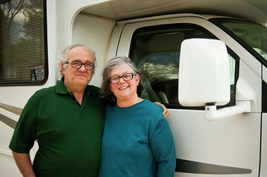 Debra and Lyle 'Chip' Smith of Midland pose for a portrait in front of their RV on April 12 at their home. The couple traversed across the South, Southwest and even into western Canada during a road trip this past winter. (Katy Kildee/kkildee@mdn.net)