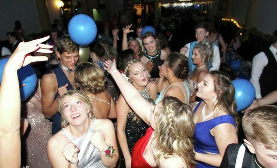 This top-of-the-crowd shot shows Laker students laughing, smiling and dancing all while enjoying their prom celebration Saturday night at the Pasta House in Kinde. For more photos of the night, see Page 8A. (Coulter Mitchell/Huron Daily Tribune)