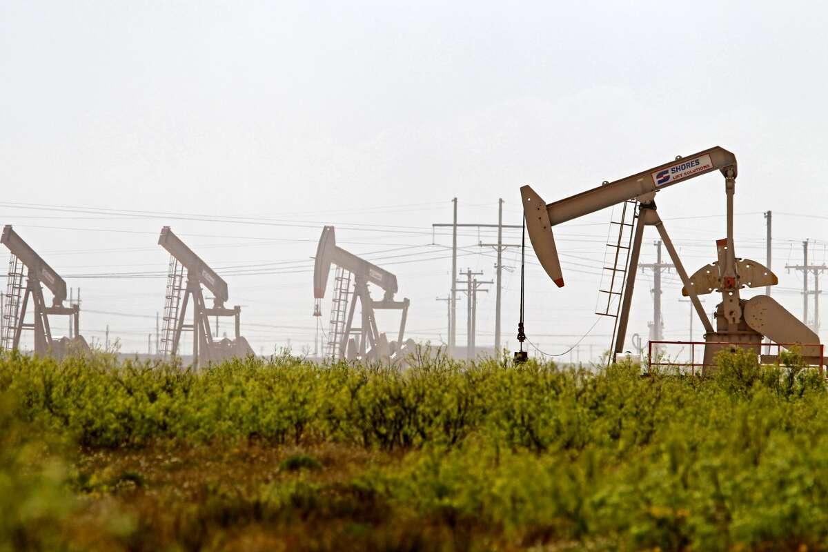 Pumpjacks operate near a Diamondback oil and gas operation, April 17, 2019, in Midland County, Texas. James Durbin / Reporter-Telegram