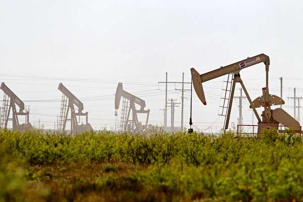 Pumpjacks operate near a Diamondback oil and gas operation, April 17, 2019, in Midland County, Texas. James Durbin / Reporter-Telegram