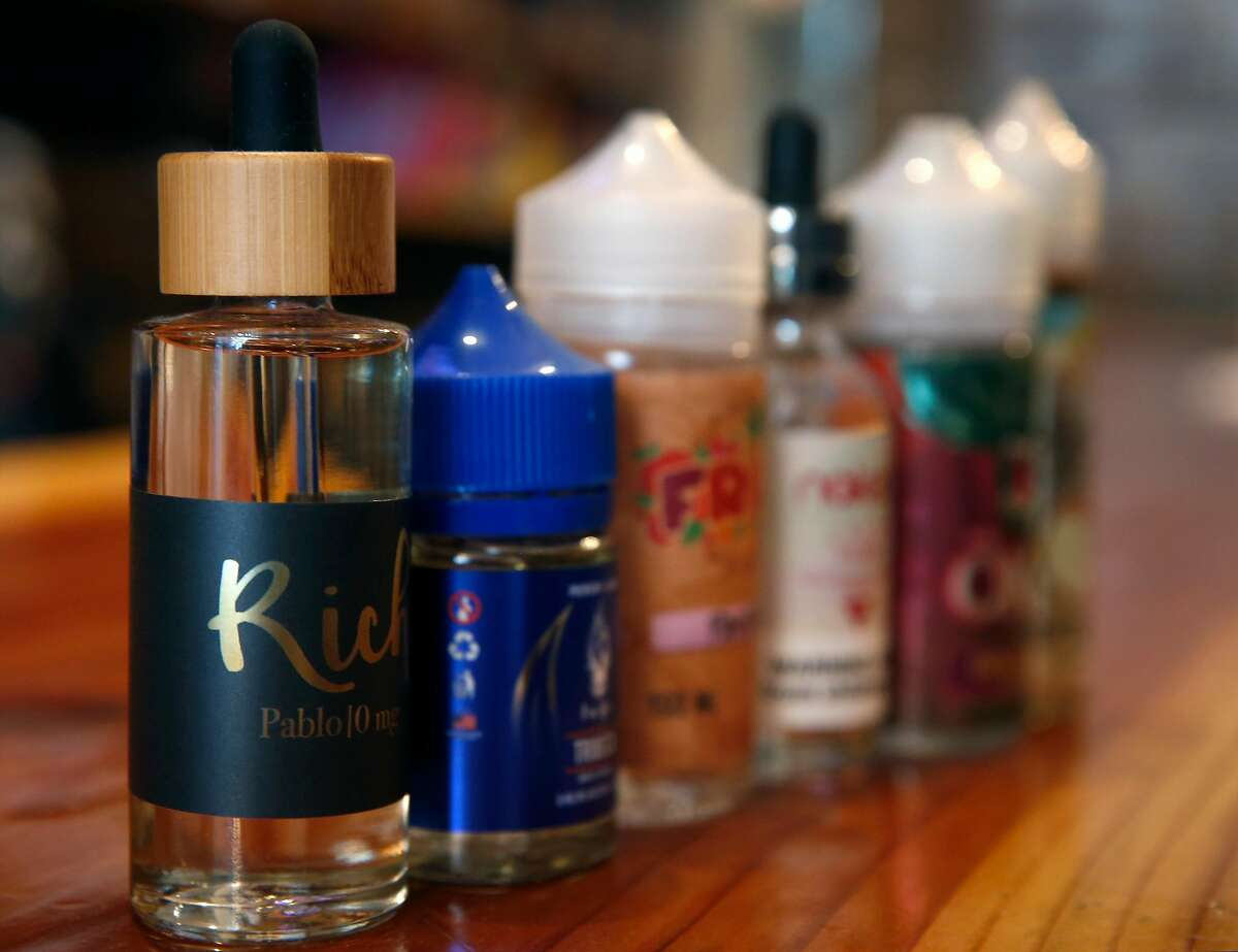 Bottles of eJuice are displayed at the Gone With the Smoke Vapor Lounge in San Francisco, Calif. on Thursday, May 9, 2019. Chris Chin would be forced to shut down his business if proposed legislation is passed banning the sale of e-cigarettes in the city.