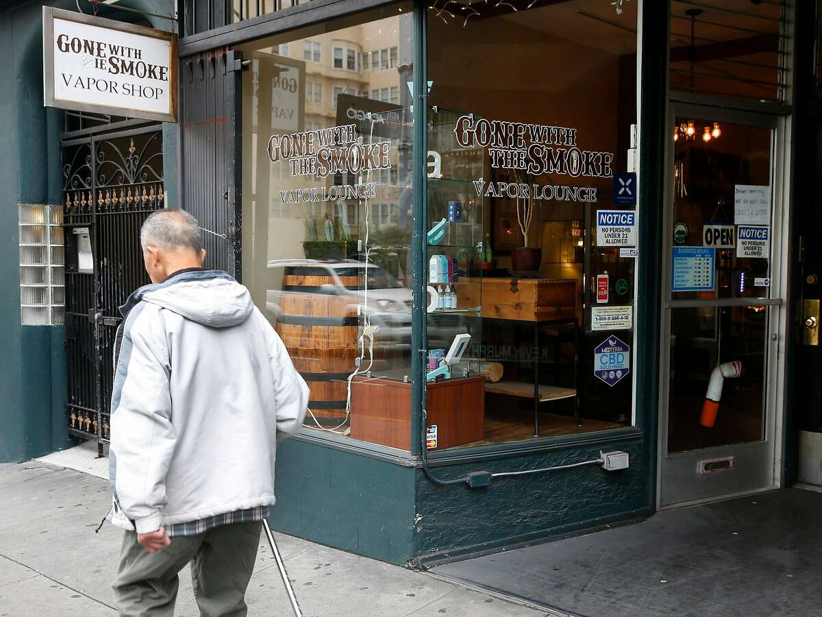 A man walks past the Gone With the Smoke Vapor Lounge on Geary Street in San Francisco, Calif. on Thursday, May 9, 2019. Chris Chin would be forced to shut down his business if proposed legislation is passed banning the sale of e-cigarettes in the city.