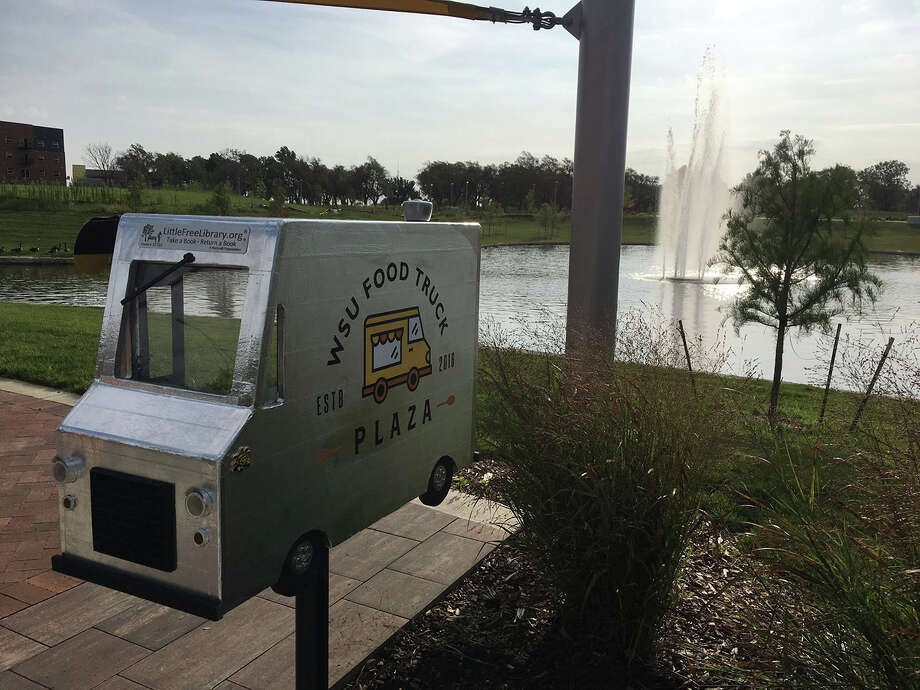 A themed Little Free Library was created for Wichita State University's Food Truck Plaza in Wichita, Kansas. Installed in July 2017, it features working headlights. Photo: Handout Photo Courtesy Of Ellen Abbey / Handout