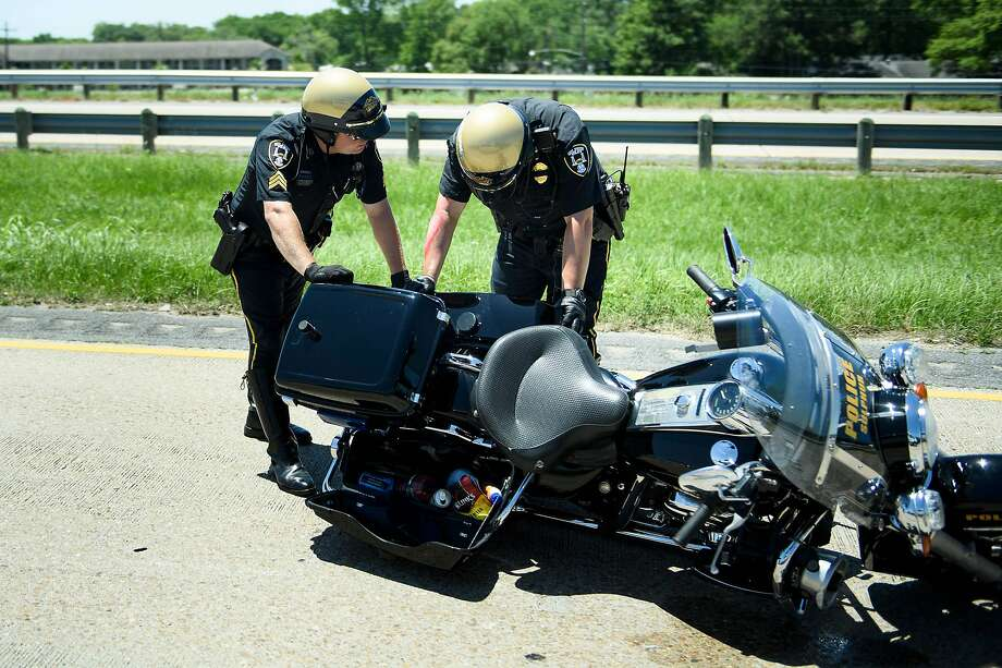 Police Officers move a police motorcycle involved in an accident while escorting a motorcade with US President Donald Trump from Chennault International Airport May 14, 2019, in Lake Charles, Louisiana. (Photo by Brendan Smialowski / AFP)BRENDAN SMIALOWSKI/AFP/Getty Images Photo: Brendan Smialowski, AFP/Getty Images