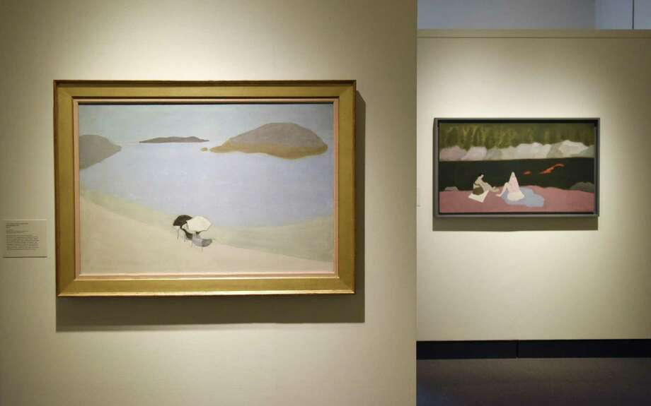 """Milton Avery's 1956 piece """"Sea Gazers,"""" left, and 1945 piece """"Swimmers and Sunbathers"""" is displayed at the """"Summer with the Averys"""" exhibit at the Bruce Museum in Greenwich, Conn. Tuesday, May 14, 2019. The work features earth scenes and figural compositions as well as rarely-seen travel sketchbooks produced by Milton Avery, his wife Sally Michel, and their daughter, March Avery. The Avery family would spend their summer at artists' residences and come back with sketchbooks full of ideas upon which to expand. Milton Avery's work is often compared to that of Henri Matisse and is seen as momentus in the scope of representational American abstract painting. Photo: Tyler Sizemore / Hearst Connecticut Media / Greenwich Time"""