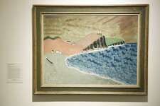 """Work is displayed at the """"Summer with the Averys"""" exhibit at the Bruce Museum in Greenwich, Conn. Tuesday, May 14, 2019. The work features earth scenes and figural compositions as well as rarely-seen travel sketchbooks produced by Milton Avery, his wife Sally Michel, and their daughter, March Avery. The Avery family would spend their summer at artists' residences and come back with sketchbooks full of ideas upon which to expand. Milton Avery's work is often compared to that of Henri Matisse and is seen as momentus in the scope of representational American abstract painting."""