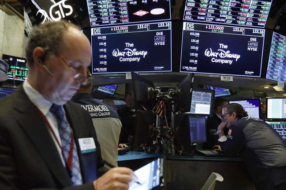 The logo for The Walt Disney Company appears above trading posts on the floor of the New York Stock Exchange, Tuesday, May 14, 2019. Disney is taking full control of Hulu, extending the reach of its streaming abilities. Disney said Tuesday that it's taking operational control of the streaming service immediately. (AP Photo/Richard Drew) Photo: Richard Drew / Associated Press