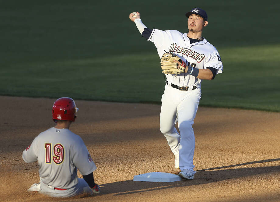 San Antonio second baseman Keston Hiura turns a double play in the first inning after forcing out Ramon Urias on second as the Missions open the season at home against the Memphis Redbirds on April 9, 2019. Photo: Tom Reel, Staff Photographer; San Antonio Express-News