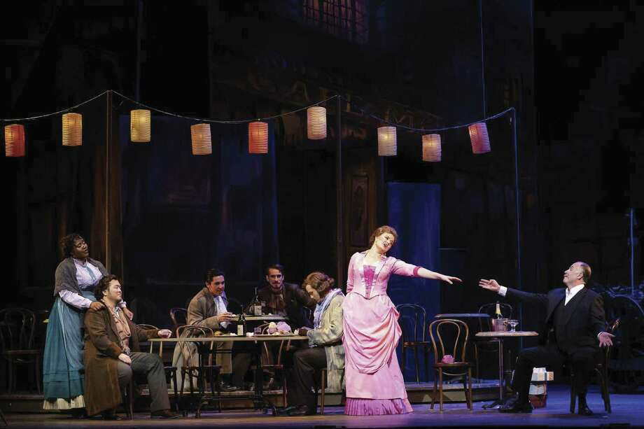 A cast from the Houston Grand Opera performs 'La Bohéme.' The show will be performed at the Cynthia Woods Mitchell Pavilion on Wednesday, May 22, at 8 p.m.