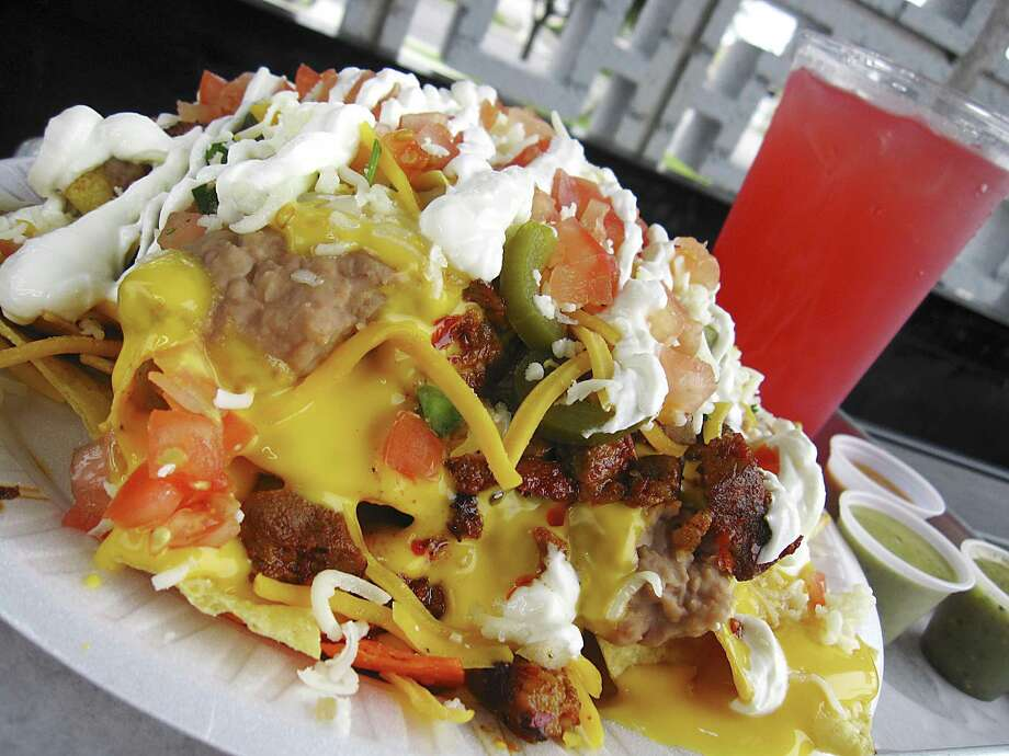 Nachos with pork adobado are an option at Macho Libre. Photo: Mike Sutter /Staff