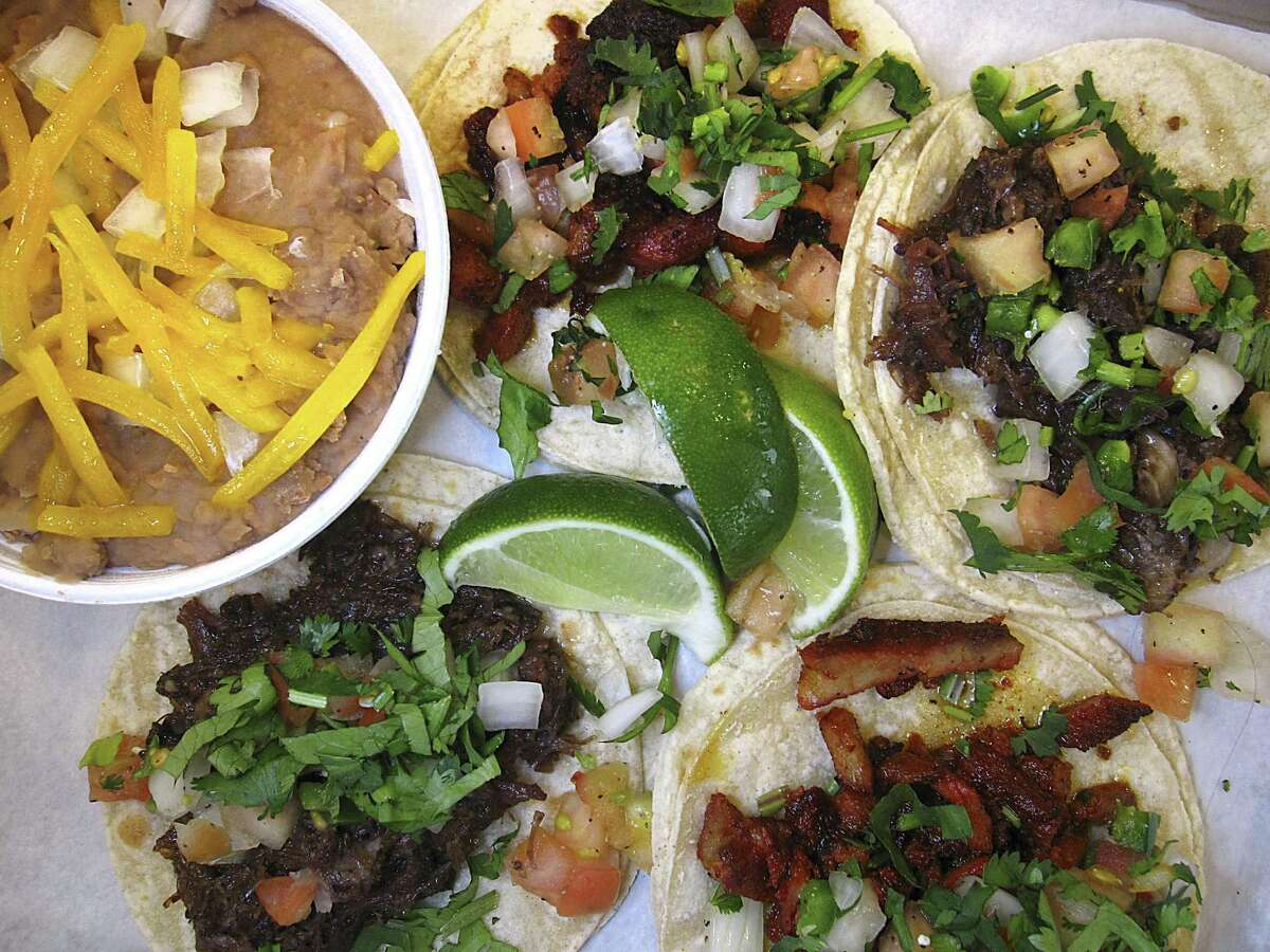 Street tacos can be ordered with barbacoa and pork al pastor on weekends at Macho Libre.
