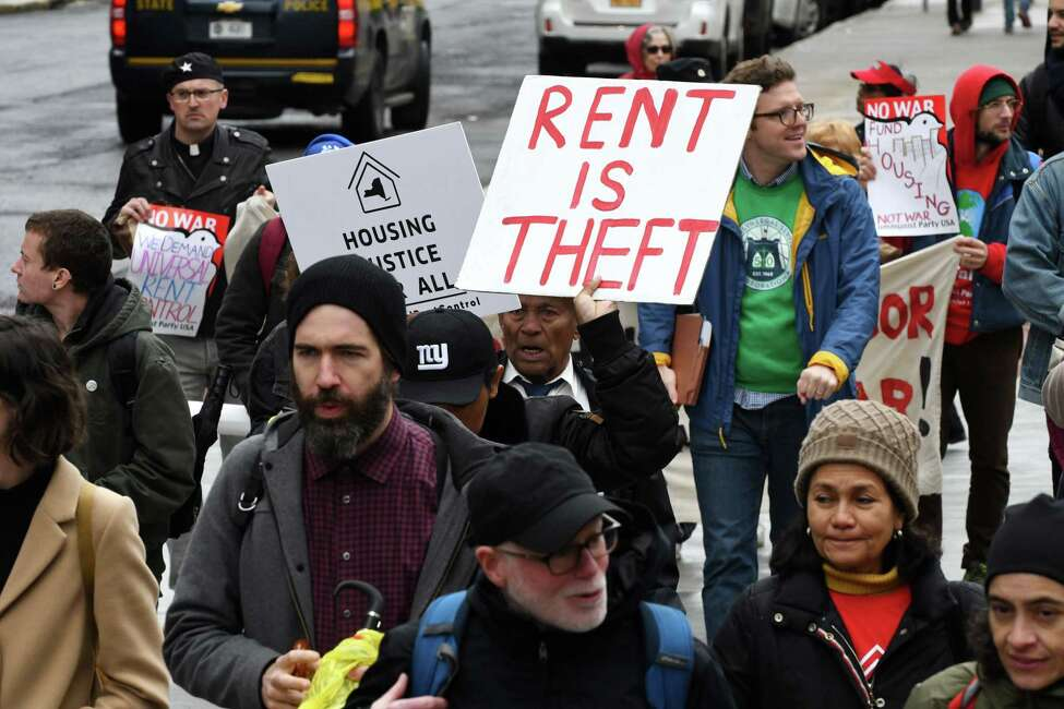 Rent control advocates march up State Street during a rally on Tuesday, May 14, 2019, in Albany, N.Y. Demonstrators are asking lawmakers to strengthen renter protections. (Will Waldron/Times Union)