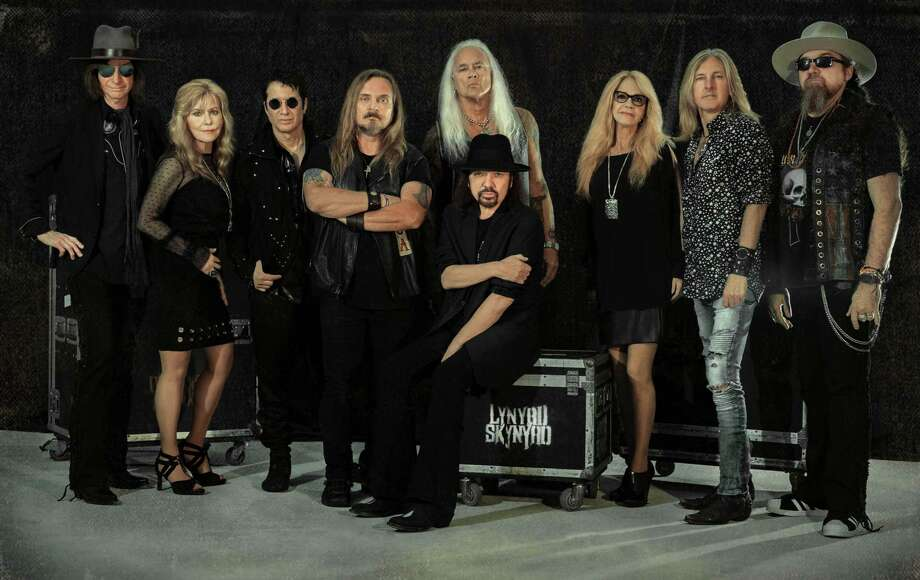 "Lynyrd Skynyrd will perform at Mohegan Sun Arena on May 24. Standing, from left, are Keith Christopher (bass guitar), Carol Chase (background vocals), Michael Cartellone (drums), Johnny Van Zant (lead vocals), Rickey Medlocke (guitar), Dale Krantz Rossington (background vocals), Mark ""Sparky"" Martejka (guitar) and Peter Keys (keyboard). Seated: Gary Rossington (guitar) Photo: Doltyn Snedden / Contributed Photo"
