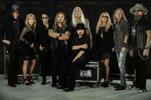 """Lynyrd Skynyrd will perform at Mohegan Sun Arena on May 24. Standing, from left, are Keith Christopher (bass guitar), Carol Chase (background vocals), Michael Cartellone (drums), Johnny Van Zant (lead vocals), Rickey Medlocke (guitar), Dale Krantz Rossington (background vocals), Mark """"Sparky"""" Martejka (guitar) and Peter Keys (keyboard). Seated: Gary Rossington (guitar)"""