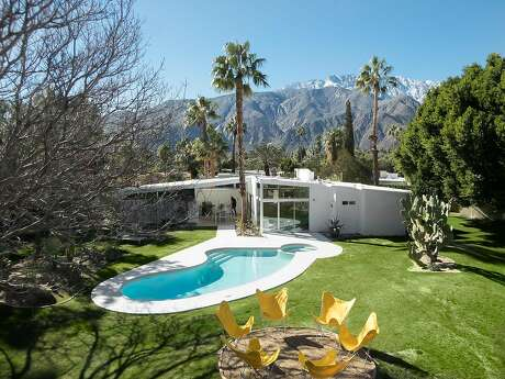 This Palmer & Krisel designed home near downtown Palm Springs includes a pool, spa and garden of fruit trees. It's available for rent on Homes & Villas by Marriott International.