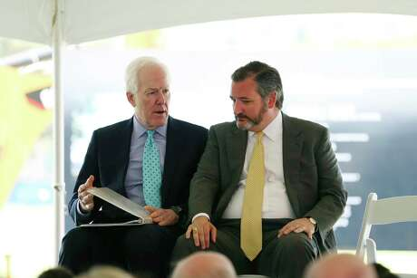 U.S. Sen. John Cornyn, left, talks with fellow Sen. Ted Cruz before the start of a ground breaking ceremony for the US Courthouse at the former site of the San Antonio Police Department on the 200 block of West Nueva Street, Monday, March 18, 2019.