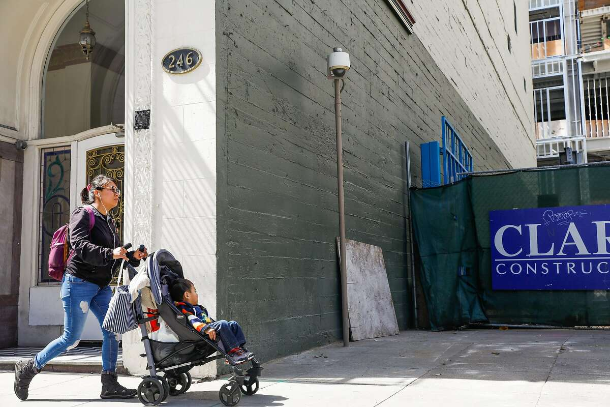 A woman pushes a stroller with a child passing a security camera on McAllister Street in San Francisco, California, on Monday, May 13, 2019. The Board of Supervisors is considering a proposal to ban city departments from using facial recognition software. While privacy advocates applaud the move, others say it will keep the city from a useful tool in crime solving. San Francisco law enforcement agencies such as the police department and District Attorney's office, say they do not use facial recognition software.