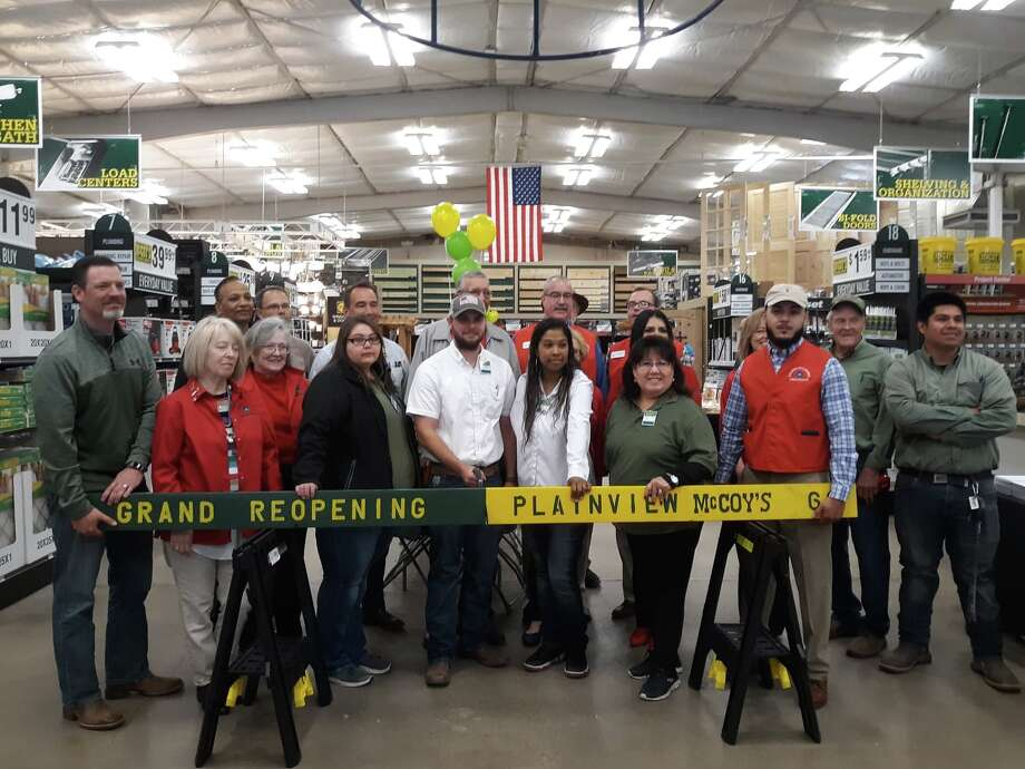 McCoy's employees and members of the Plainview Chamber of Commerce celebrate the grand re-opening of the store with a board cutting on Thursday. Photo: Kaelene Hansen/For The Herald