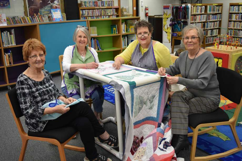 A few members of the Creative Quilters Group took time to chat with interested community members last week when their blankets were hung for display at Unger Memorial Library. Photo: Ellysa Harris/Plainview Herald
