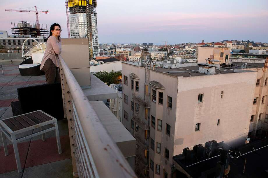 Jessica Samples, on her rooftop, says smoke from the restaurant Espetus below ruins her home air quality. Photo: Photos By Santiago Mejia / The Chronicle