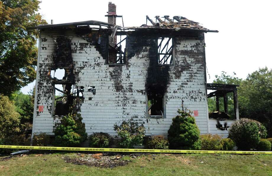 The Locust Road home that was destroyed by fire last August. The town continues to debate the need for another fire station in the northwest corner of Greenwich. Photo: Hearst Connecticut Media File Photo / Norwalk Hour