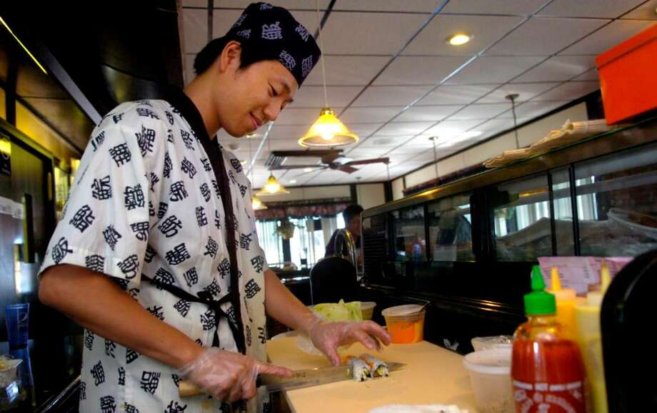 Sushi Chef C. C. Li prepares a roll at East China and Sushi Bar in Stratford on Tuesday, July 27, 2010. Photo: Lindsay Niegelberg / Connecticut Post