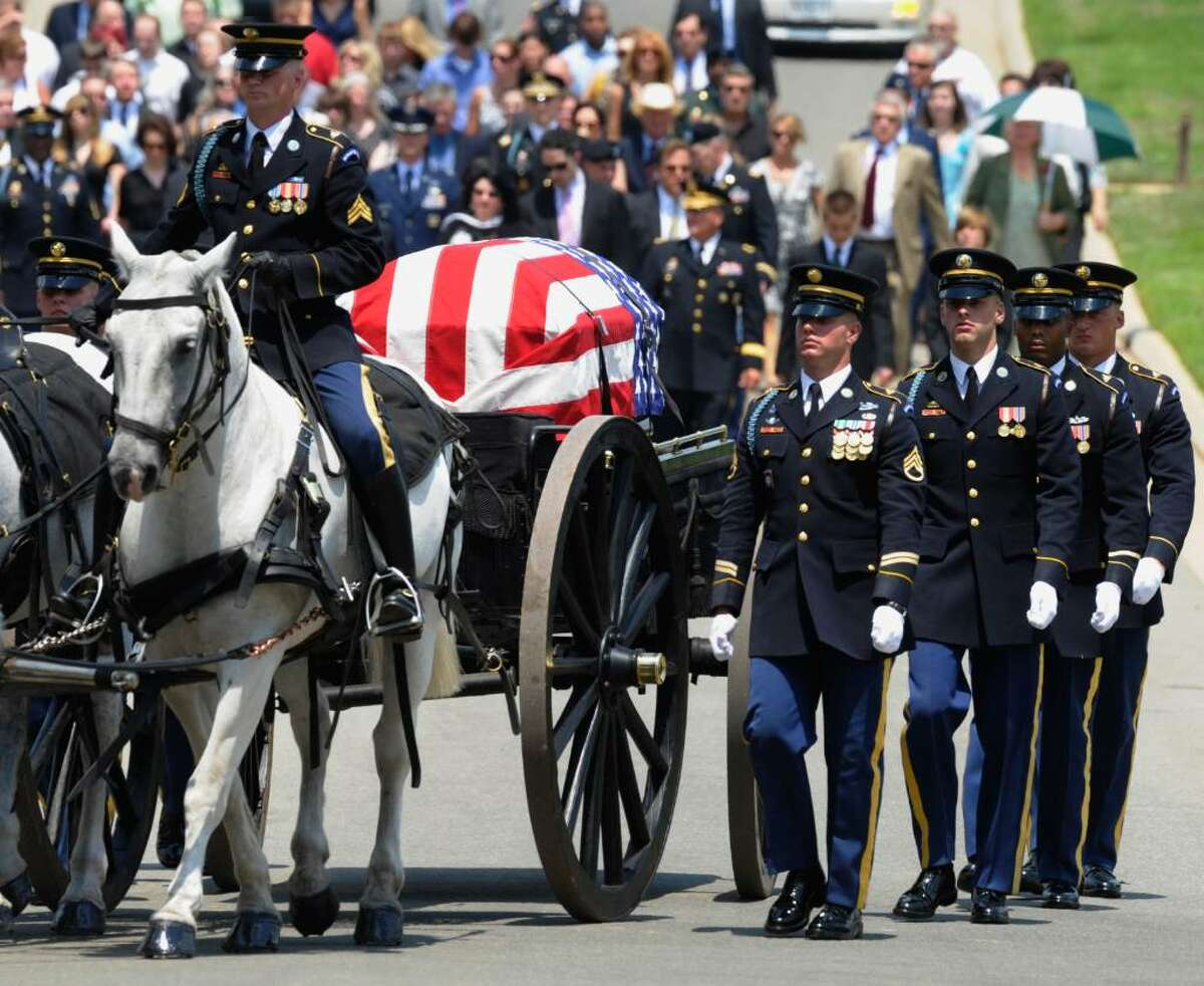 A caisson with the casket of Army Pfc. David Taylor Miller is carried to the burial site during his funeral services at Arlington Cemetery in Arlington, Va., Wednesday, July 28, 2010. Miller of Wilton died June 21 in Afghanistan. (AP Photo/Susan Walsh)