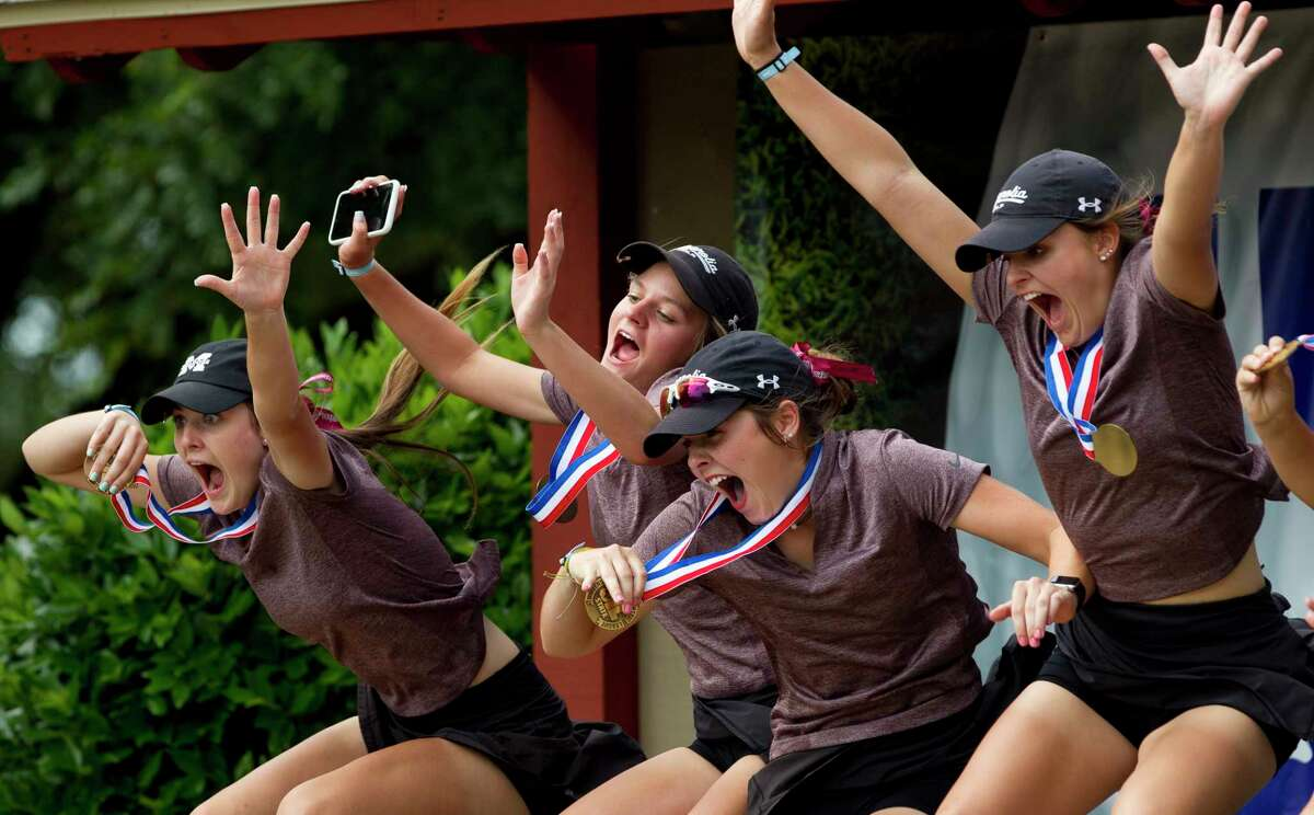 Magnolia players jump for a photo after finishing third overall during the Class 5A UIL State Golf Championships at White Wing Golf Club, May, 11, 2019, in Georgetown.