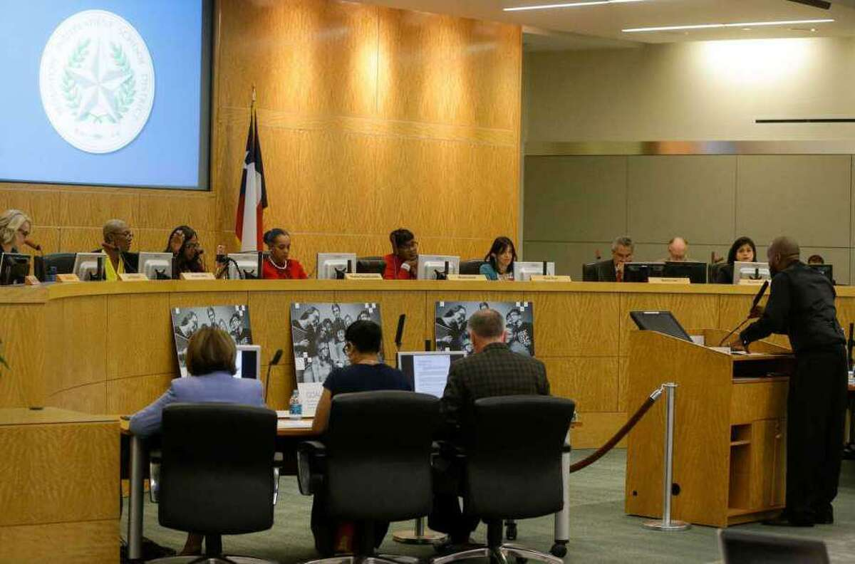 Trustees of the Houston Independent School District listen to a speaker at an April board meeting.