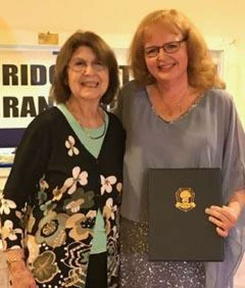 The Bridgewater Grange recently presented its Community Service Award to Carol Wilbur. Above, Nancy Mascio of the Grange, left, congratulates Wilbur at the late April meeting. Photo: Courtesy Of The Bridgewater Grange / The News-Times Contributed