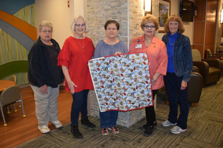 Calling themselves the Threaders, local quilters Jean Hart, Barbara DeBerry, Debbie Belk, Geneva Tipton and Lily Rinne show off one of many quilts the group has made for newborns at Covenant Health Plainview. Photo: Covenant Health Plainview