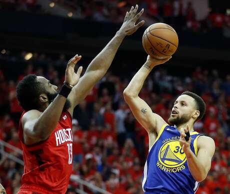Golden State Warriors guard Stephen Curry (30) takes a shot over Houston Rockets guard James Harden (13) during the second half of Game 6 of the NBA Western Conference semifinals at Toyota Center on Friday, May 10, 2019, in Houston.