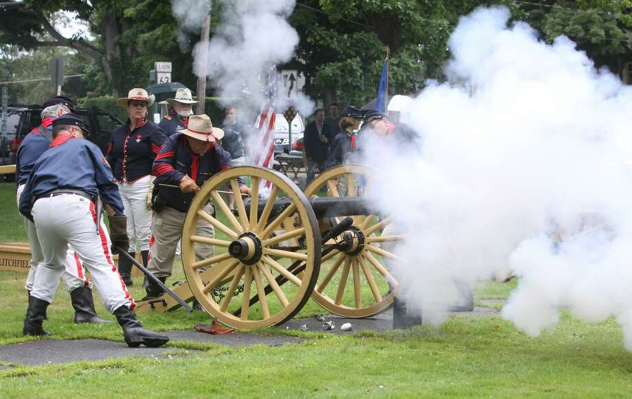 The First Litchfield Artillery fires a cannon on the Litchfield Green. Sunday, May 19, the town will celebrate its 300th year with a kickoff service, proclamation and speeches. Activities continue through the year, including a Living History Day in September. Photo: Contributed Photo /