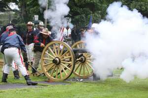 The First Litchfield Artillery fires a cannon on the Litchfield Green. Sunday, May 19, the town will celebrate its 300th year with a kickoff service, proclamation and speeches. Activities continue through the year, including a Living History Day in September.