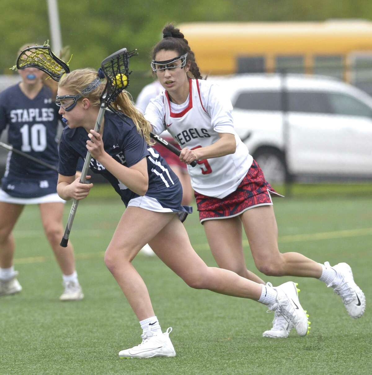 New Fairfield's Katelyn Sousa, right, defends Staples' Ellen Fair during Tuesday's game at New Fairfield High School.
