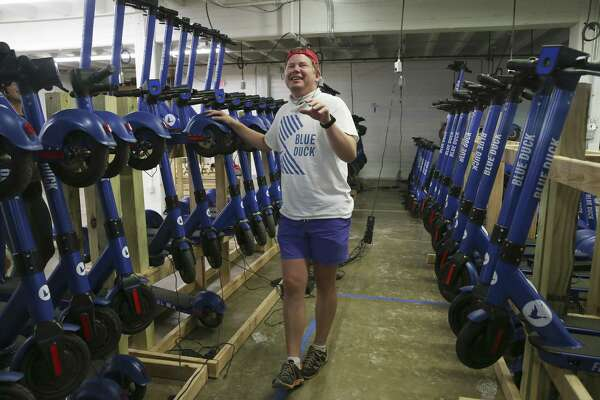 Blue Duck CEO Eric Bell laughs while working at the company's warehouse.