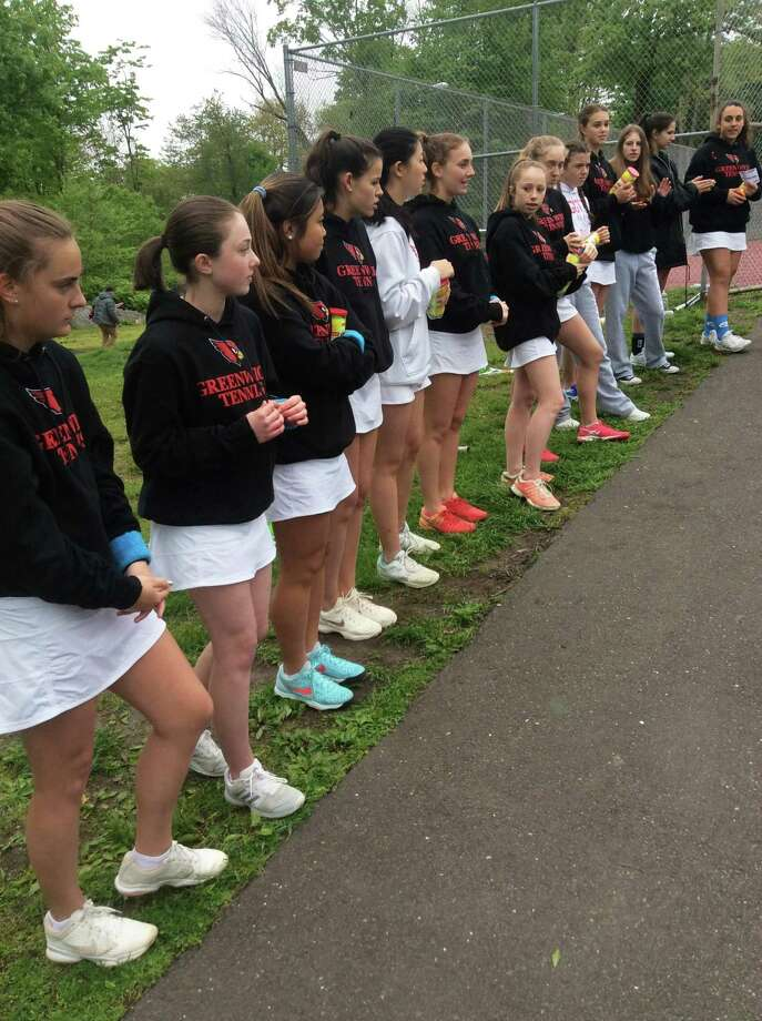 The Greenwich High girls tennis team lines up during pre-match introductions at the FCIAC quarterfinal-round match against visiting New Canaan on Tuesday. Photo: David Fierro / Hearst Connecticut Media / Connecticut Post