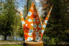 Metal sculptures are displayed at various spots within Dow Gardens on Tuesday, May 14, 2019. The exhibition, entitled Origami in the Garden, was created by Santa Fe artists Jennifer and Kevin Box. (Victoria Ritter/vritter@mdn.net)
