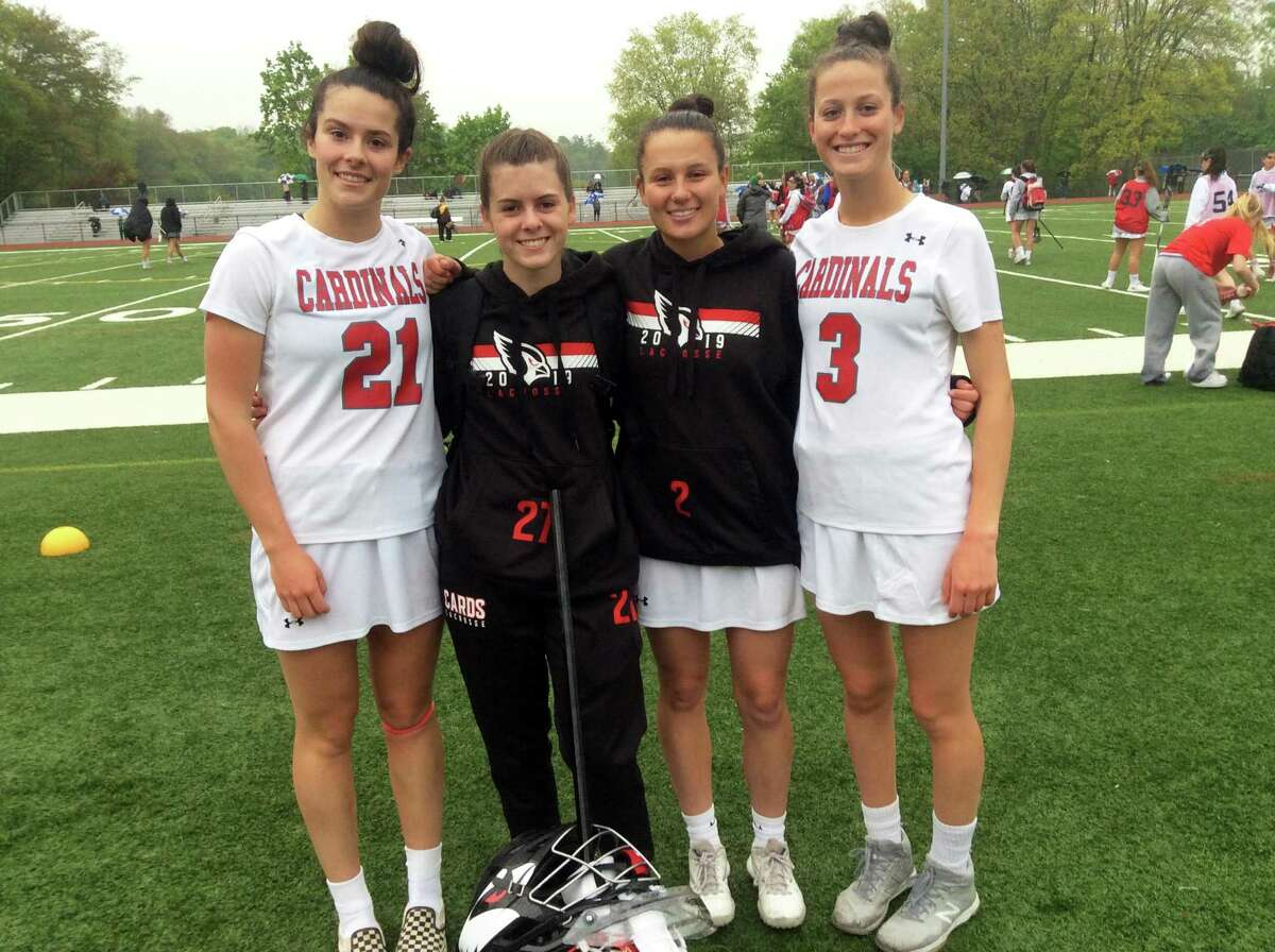 From left to right, Olivia Hoekman, Sloane Loveless, Paige Finneran and Grace Fahey are senior captains of the Greenwich High School girls lacrosse team, which ended its regular season with a 16-9 win over visiting St. Joseph on Tuesday, May 14, 2019.