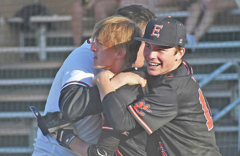 Edwardsville's Hayden Moore, center, by Evan Funkhouser, left, after hitting a walk-off home run in the seventh inning against O'Fallon at Tom Pile Field. Photo: Matt Kamp/Intelligencer