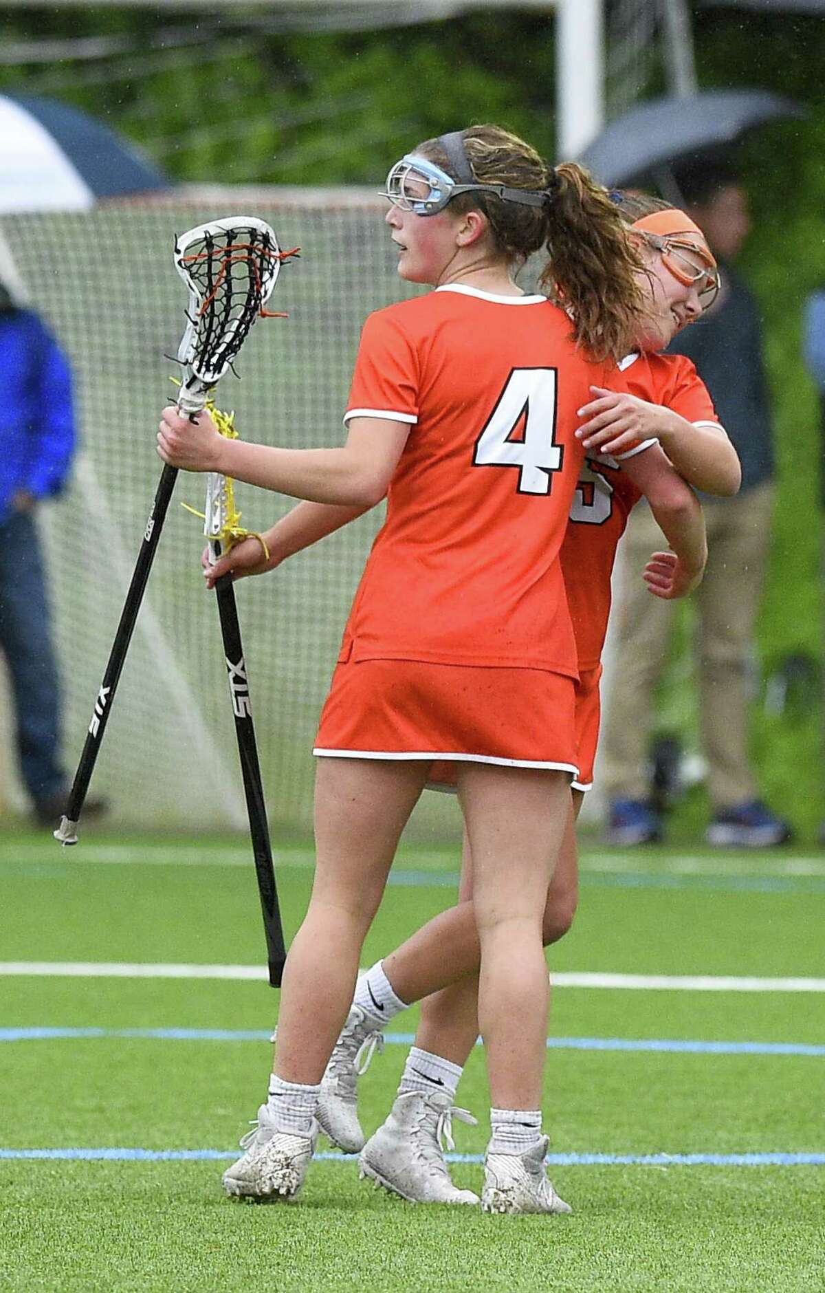 Ridgefield Caitlin Slaminko (4) celebrates her goal against Wilton with teammate Riley Peters in a girls lacrosse game at Wilton High School on May 14, 2019 in Wilton, Connecticut. Ridgefield defeated Wilton 10-8.