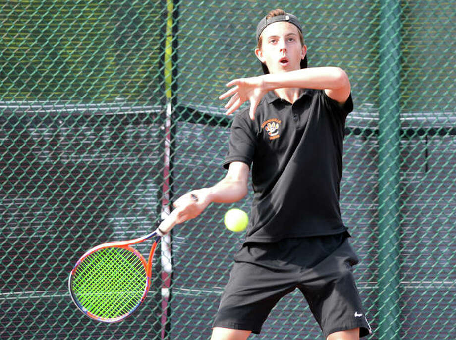 Edwardsville senior Drake Schreiber returns a shot in his No. 2 doubles match during Tuesday's Southwestern Conference dual match at Belleville West. Photo: Scott Marion/The Intelligencer