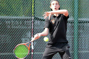 Edwardsville senior Drake Schreiber returns a shot in his No. 2 doubles match during Tuesday's Southwestern Conference dual match at Belleville West.